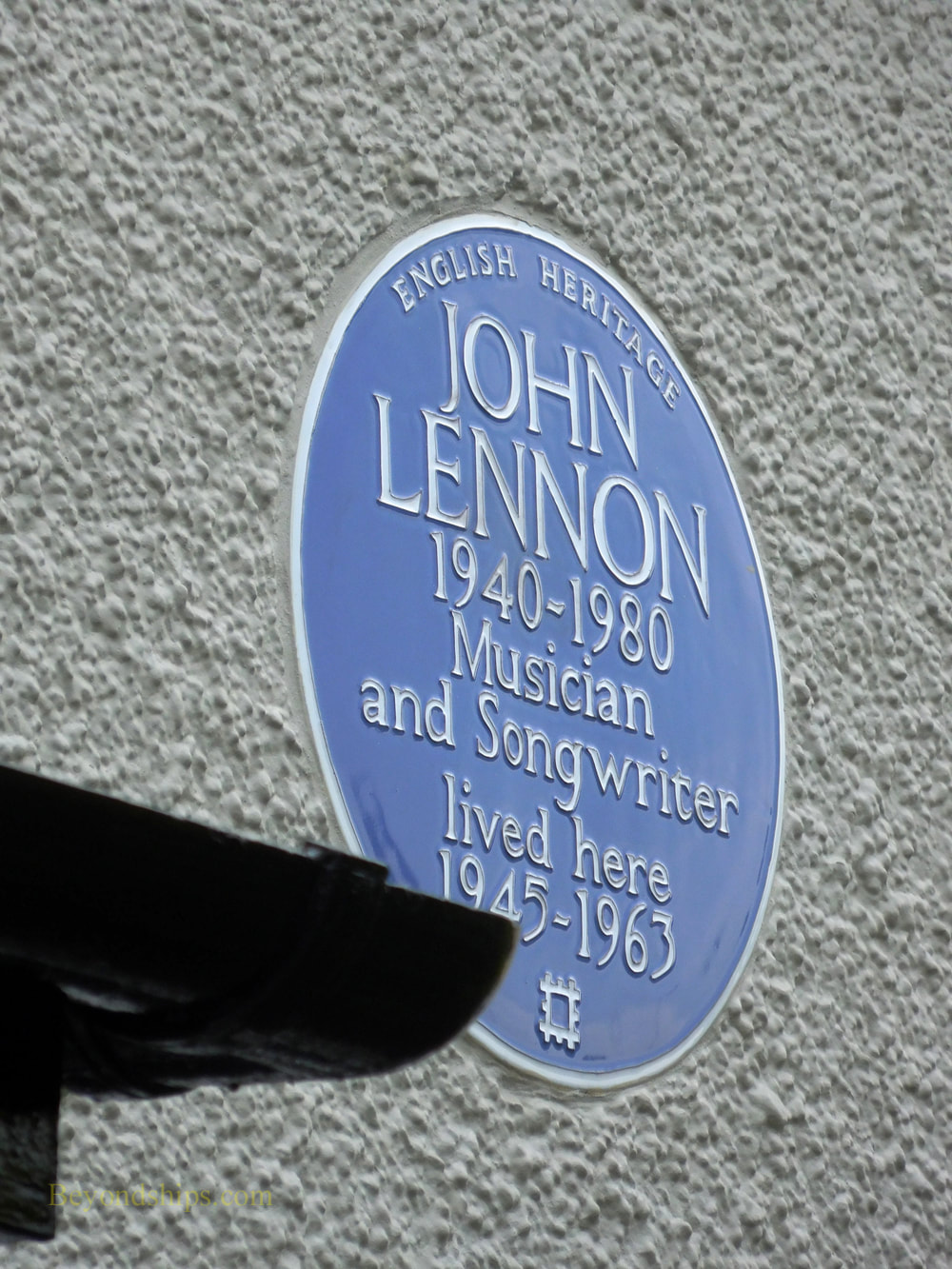 Blue plaque showing that Jon Lennon lived at Menips, Liverpool England